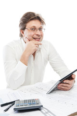 Businessman using tablet PC in office isolated