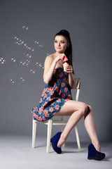 beautiful brunette girl with bubbles