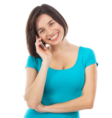 Young smiling brunette talking on the phone