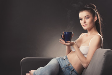 beautiful sexy girl in bra with cup of coffee