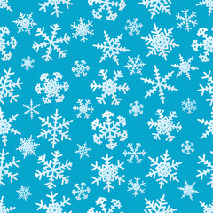 Snowflakes on blue background seamless pattern