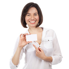 Smiling young beauty showing a white business card