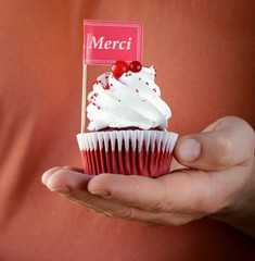 festive red velvet cupcakes with a gift compliment card