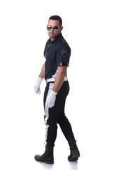 Studio shot of trendy serious policeman