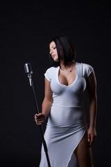 Image of busty slim singer posing in studio