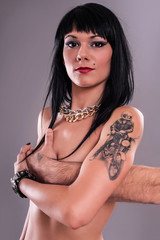 Attractive Tattoo Girl. Studio shoot.