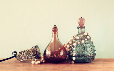 vintage antigue perfume bottles, on woode