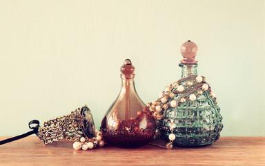 vintage antigue perfume bottles, on woode
