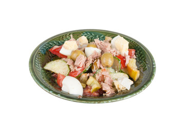 Salad of tuna with vegetables and cheese in a green bowl isolate