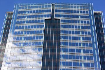 Close up of symmetrical architecture of modern skyscraper