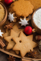 Assorted Christmas cookies, decorations and spices, top view