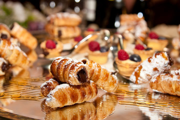 cannoli with chocolate and various pastries