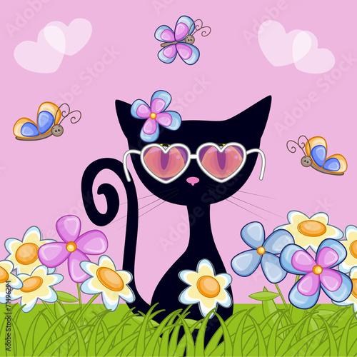 Black kitten with flowers