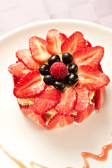 Cake with strawberries, blueberries and raspberries