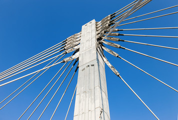 Pillar of cable bridge against blue sky