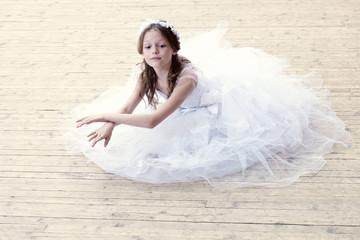 Charming girl dancing in ballet studio