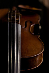Detail of a violin on a black background