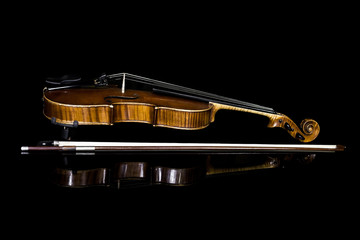 Violin lying on a black background