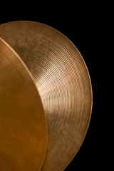 Detail of orchestral cymbals on a black background