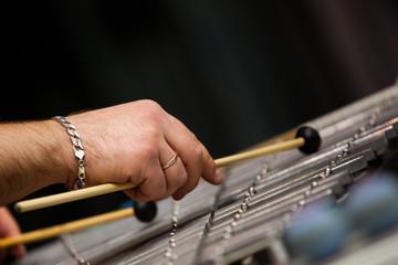 Human hands playing a glockenspiel closeup