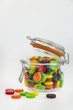 Jar of colorful candy on a white background