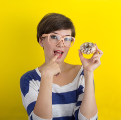 A girl with a donut