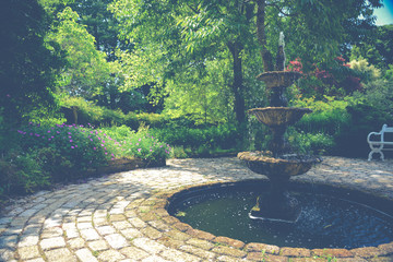 Fountain and pond in vintage Cornish garden