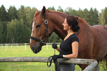 Portrait of brunette woman and brown horse