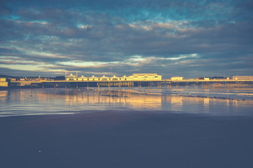 British pier in Paignton at sunset with sky background