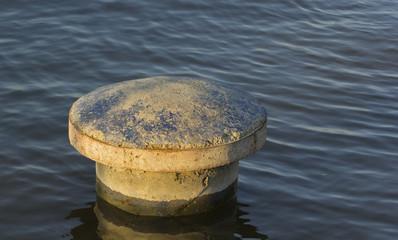 Mooring bollard on water