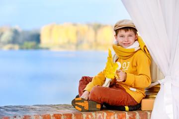 Cute little boy outdoors in autumn park
