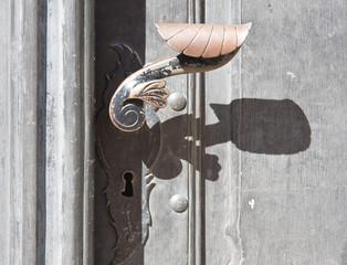 Detail of an old door with handle