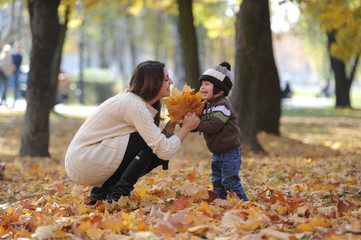 mother and the little son together walk in the park