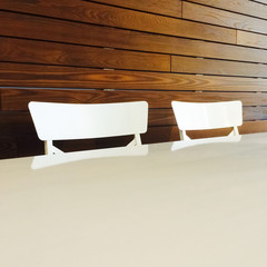Modern style white chairs and table
