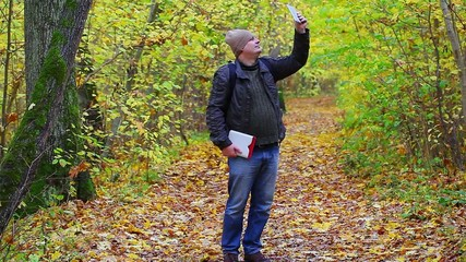 Hiker filmed with tablet PC in the park