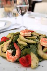 Plate with seafood and avocado salad