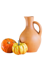 Jug and two pumpkins on a white background