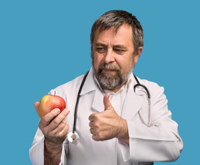 Doctor giving apple for healthy eating