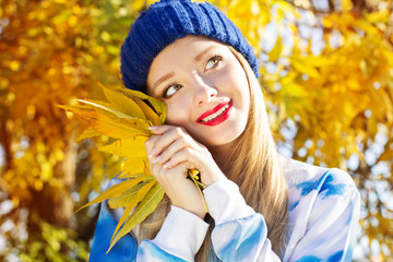 Autumn woman happy with colorful fall leaves