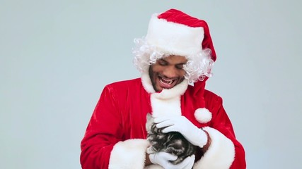 Santa Claus stroking a kitten and meowing