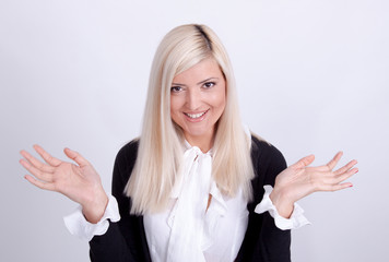 Portrait of casual dressed blond woman posing with arms crossed