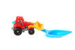 Two plastic toys. Shovel and tractor.