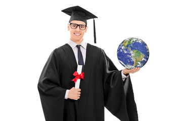 College graduate holding a diploma and the world