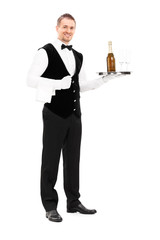 Professional waiter holding a tray with champagne