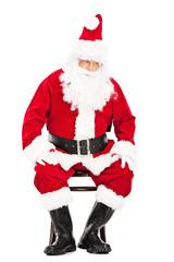 Worried Santa Claus sitting on a chair