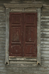 The old shabby wood closed window by shutters