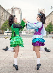Two women in irish dance dresses dancing