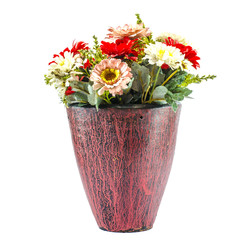 Colorfull plastic flowers in potery jar