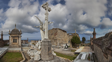 Old cemetery by the sea. Comillas, Cantabria, Spain.