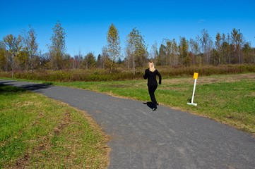 Woman jogging in a park on a fall day